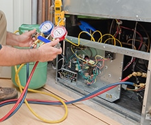 Furnace repair technician monitoring gauges
